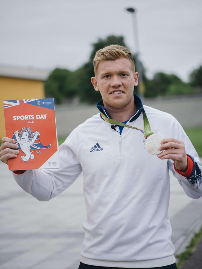 Sam Cross, a rugby sevens Olympic silver medalist at Rio 2016, with the Team GB sports day pack