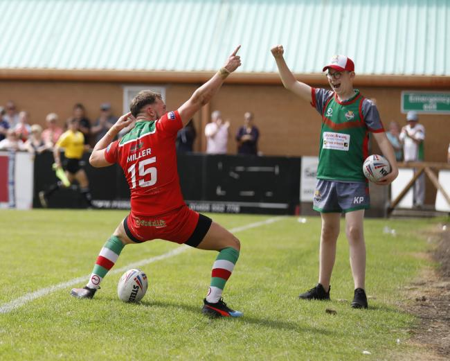 Jack Miller celebrates his try against London Skolars in front of the fans and an excited ball boy. Picture: Charlie Perry