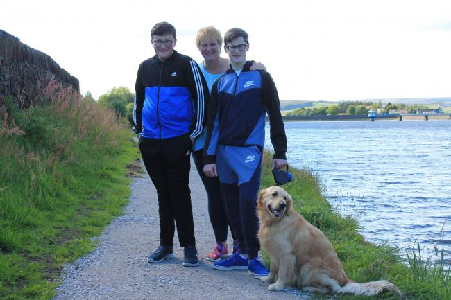 From left, Tom, Samantha and Henry Jepson, with their dog Disney at the reservoir