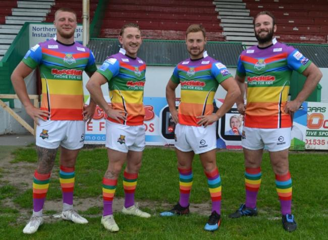 members of the Keighley Cougars squad model the special Pride kits their players will wear against West Wales Raiders on Sunday