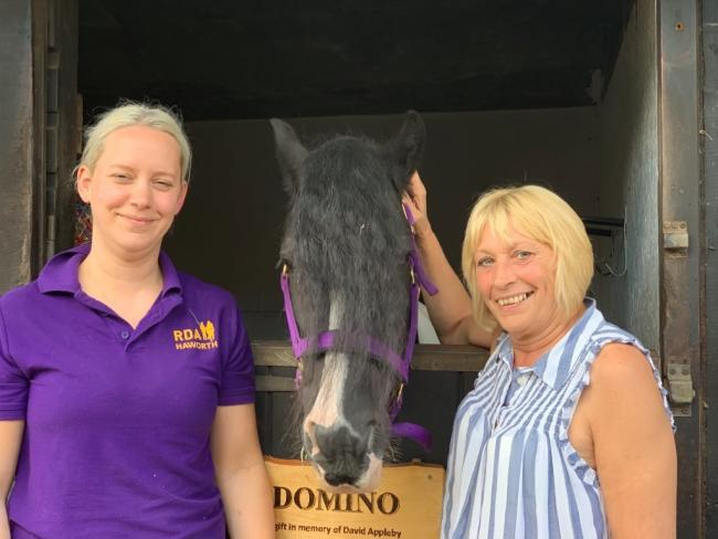 Haworth RDA head coach Laura Butterfield and Gill Hanson, who was David's carer, with Domino