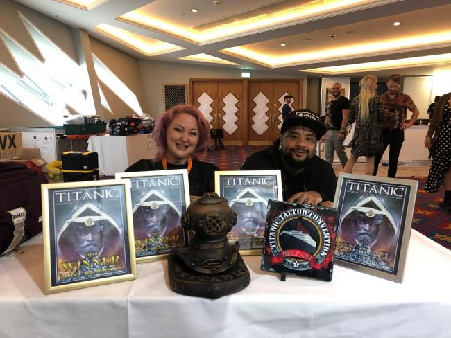 Lucy Thompson and Luke Naylor with the prizes they brought back from the Titanic International Tattoo Convention