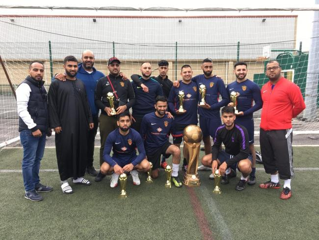 Participants in the 1Vision/Keighley Bhai Bhai charity soccer match, with organisers Razaq Hussain and Aroj Ali at the far left