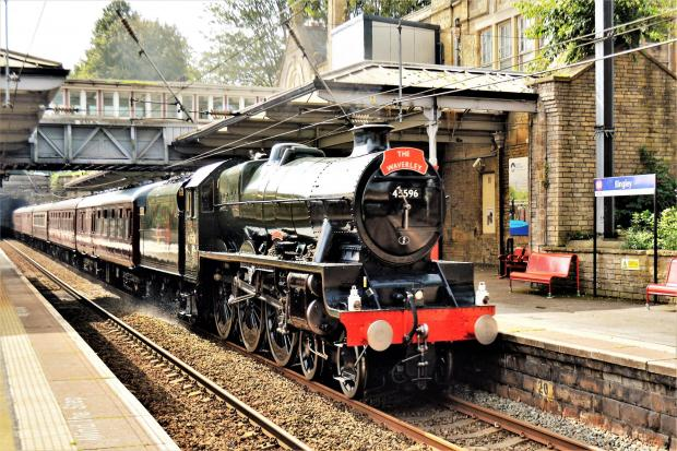 The 45596 Bahamas heads through Bingley with The Waverley. Photo by Richard Beckett.