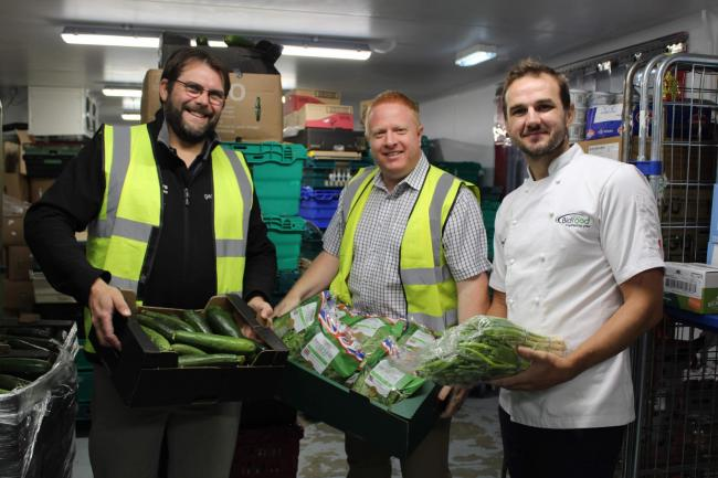 Organising the food for distribution are, from left, Pete Barringer and Gareth Batty of FareShare and Bidfood development chef, Matthew Tracey