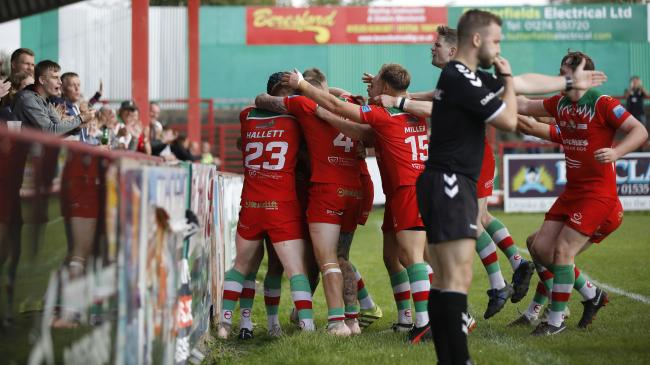 The Keighley Cougars squad celebrate Taylor Prell's try with the fans during their 32-22 defeat to Newcastle Thunder in Betfred League One at Cougar Park. Picture: Charlie Perry