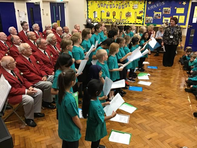 Steeton Male Voice Choir members performed at the village primary school with pupils