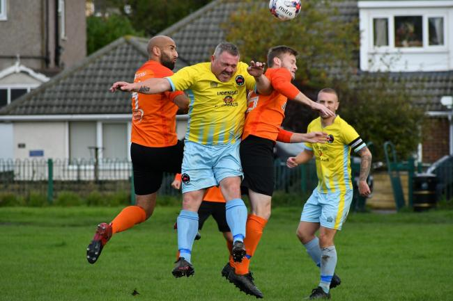 Station Hotel (orange) in action against Wrose Bull last season. They are now first and second respectively, having both recorded fantastic victories on Sunday Picture: Richard Leach.