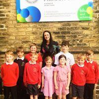 Oxenhope Primary School head Alice Jones with pupils following their successful OFSTED inspection in June