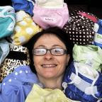 Sarah Hawken amid some of the biodegradable and washable nappies she sells online
