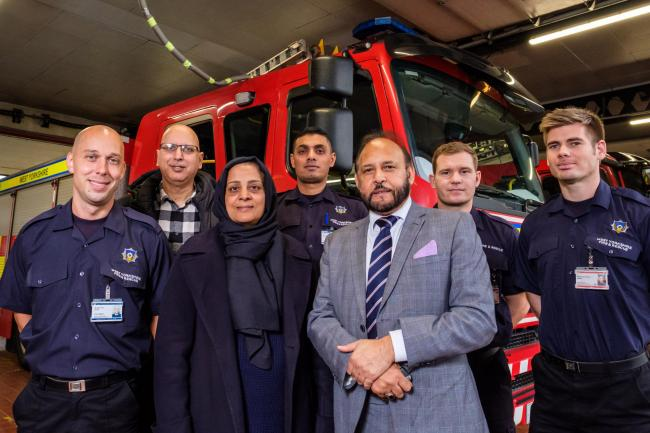 Fire fighter Adam Dykes,  Javaid Akhtar - Keighley town councillor, Naz Kazmi - manager of KAWACC Women's Centre, Ahsan Ali - watch commander, Abid Hussain - chair of Keighley Area Committee and firefighters Mike Farn and Christopher Bates at Keighl