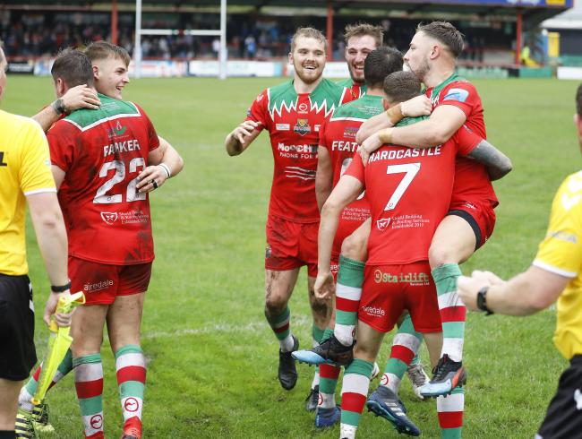 Cougars celebrate a try against Hunslet last season - they will open next year's campaign against the Leeds side