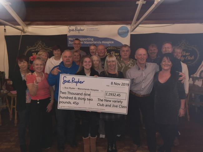 The team from the New Variety Club in Keighley hand over proceeds of music and dance events to Manorlands fundraiser Andrew Wood