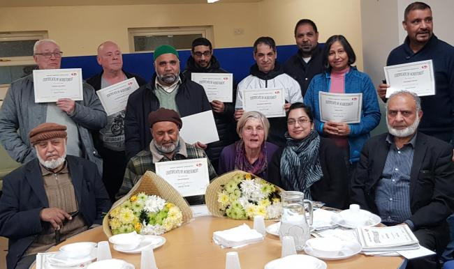 Sangat volunteers with their certificates