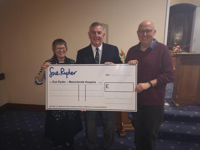 Sue Watkiss, Paul Harris and Dr Mike Hughes presented funds to the hospice
