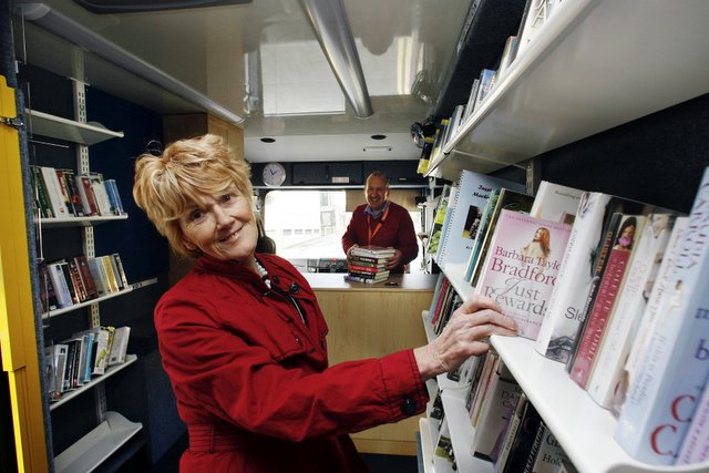 Cllr Anne Hawkesworth looks at the new mobile library with customer support assistant Stefan Bochoneck
