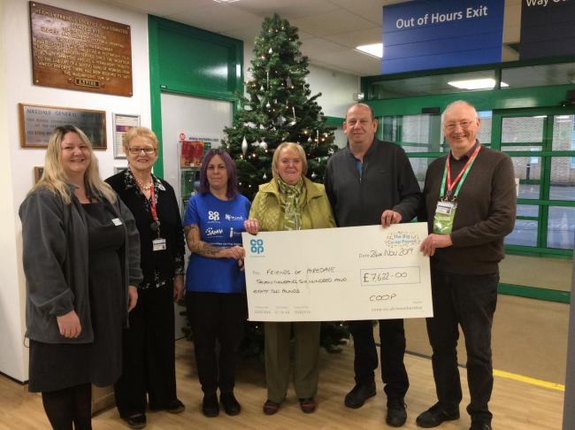 At the cheque presentation are, from left, Tanya Pople from the Co-op, Friends treasurer Enid Cheetham, Fiona Walton from the Co-op, Friends president Eileen Proud, the Co-op's Andrew Banks and Friends chairman John Lofthouse