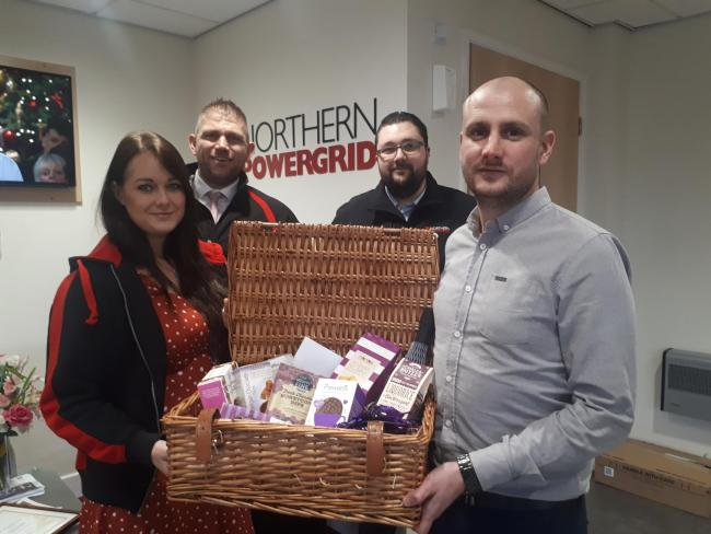 Northern Powergrid staff with one of the hampers