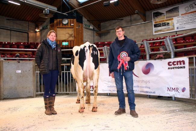 Chris Bell with his debut Craven Dairy Auction champion, and show judge Sammy Jo Sugden (photo: Moule Media, Skipton)