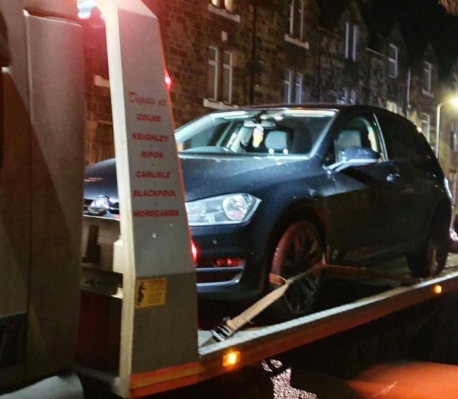 A vehicle is seized during the operation (photo: West Yorkshire Police)