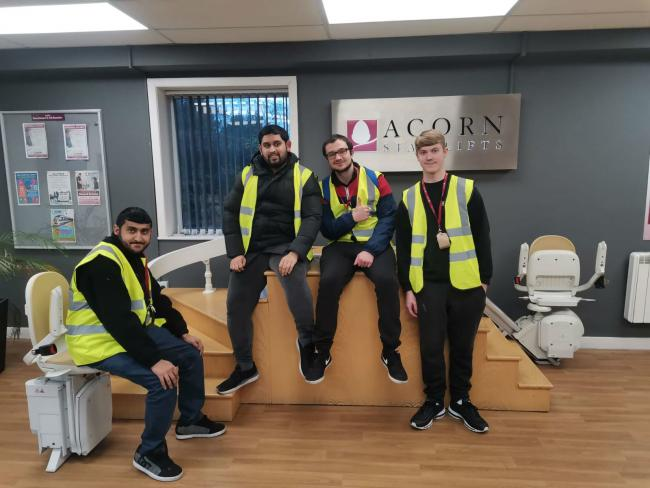 The students who are taking part in weekly work placements at Acorn Stairlifts