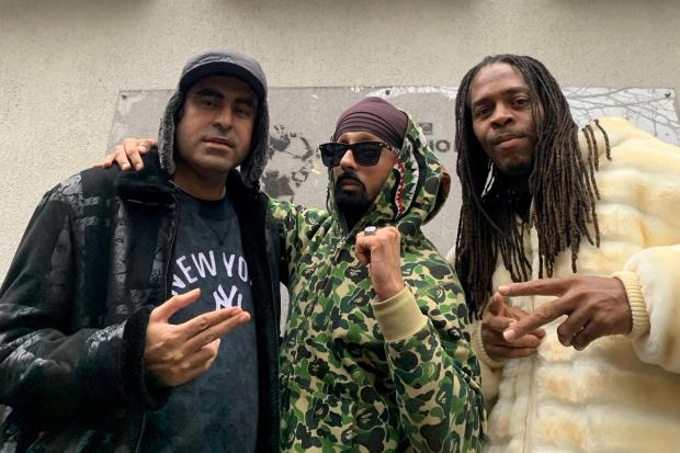 Saby Khan, left, with DJ Silverfinger Singh, centre, and rapper Nuttso