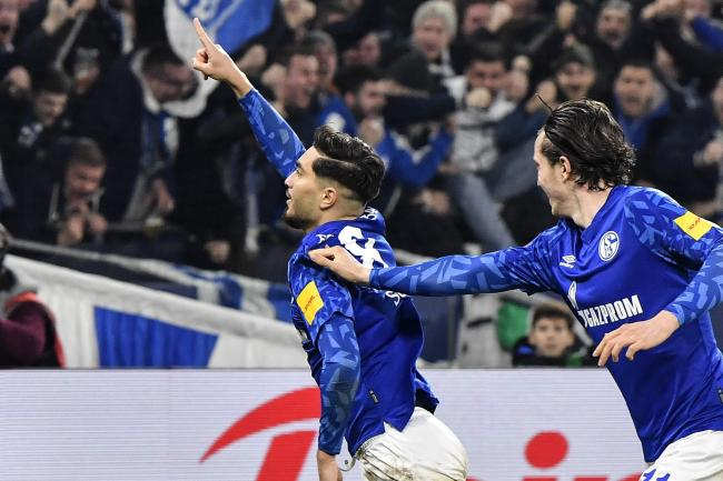 Schalke's Suat Serdar, left, celebrates his opening goal for Schalke