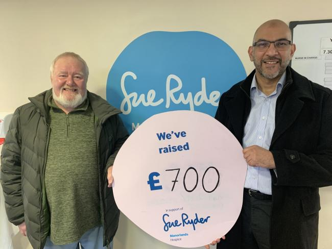 Bob Walker and Mujeeb Rahman celebrate the amount raised for Manorlands