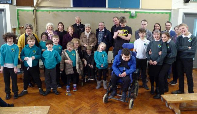 Representatives of the auction mart and Addingham Sheep Breeders' Association with children and staff from Brooklands and Manorlands staff
