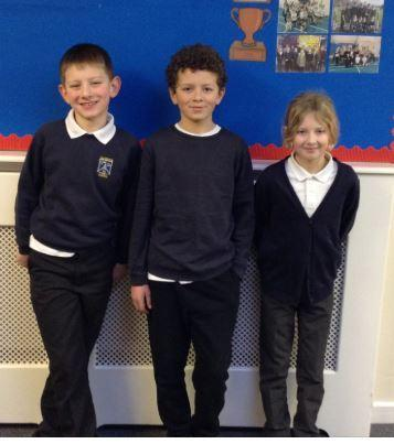 The three children from Glusburn Primary School who took part in the swimming tournament