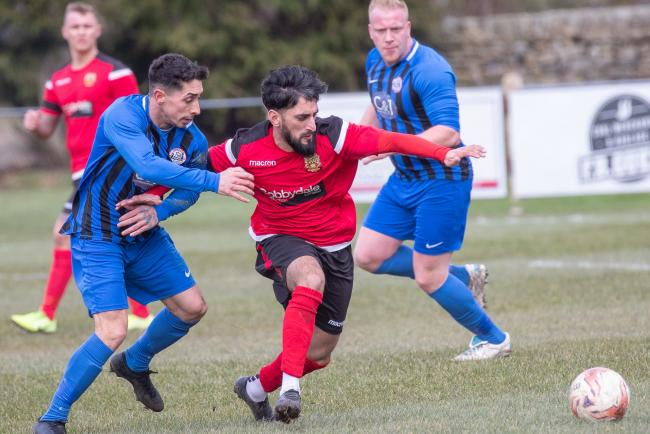 Silsden's Khurram Shazad (second right) scored his side's opening goal in their 3-2 win over Goole Picture: David Brett