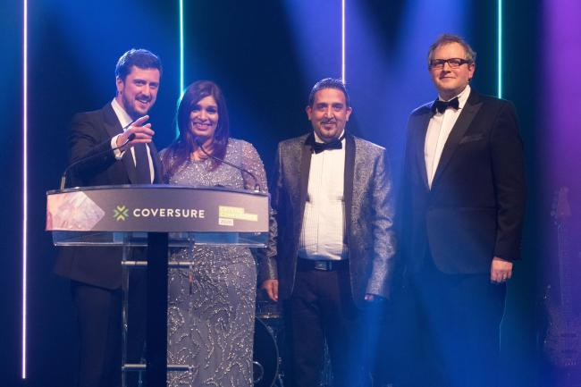 The Coversure Keighley team collects its award