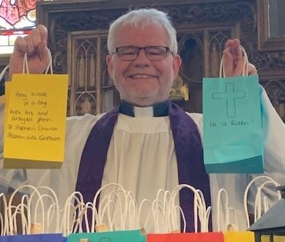 Vicar the Rev David Coleman with some of the bags