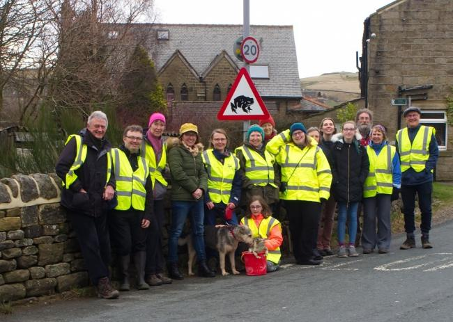Toad patrollers with one of the new signs