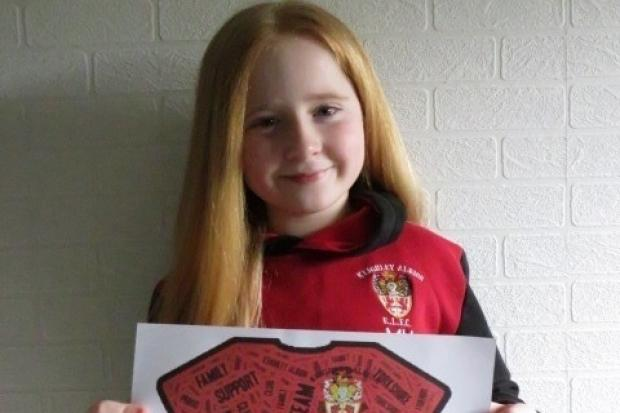 Competition winner, 10-year-old Mia Hewitt, with her shirt design