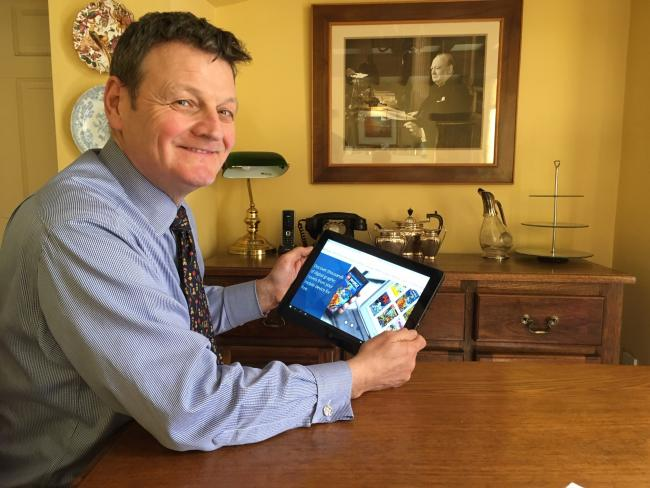 County Councillor Greg White using library services online