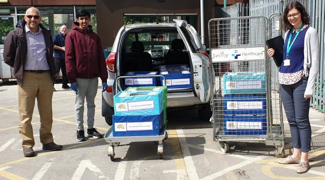 Keighley Ahmadiyya Muslim Association president Mujeeb Rahman and Munib Rahman deliver the meals to Martha Picken at Airedale Hospital