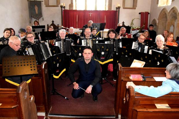 The Craven Accordion Orchestra who gave their services for free at a recent charity concert in Castle Bolton.