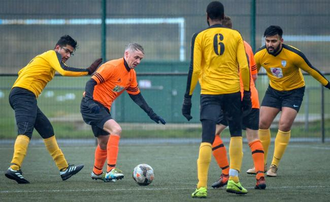 Oxenhope Recreation (orange) are starting to get back to some form of normality, in the form of Wednesday training sessions Picture: Andy Garbutt