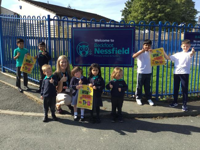 Miss Jodie Hollings and pupils give the WOW scheme the thumbs-up