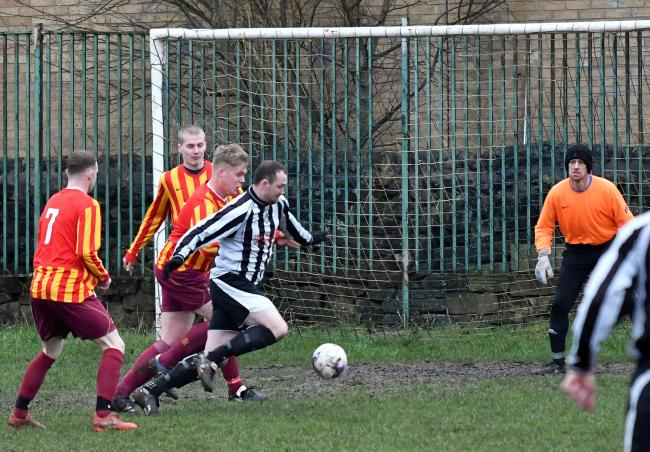 Terence Hargreaves (black and white stripes) scored for Sutton in their crazy 7-4 defeat at iPlay FC Picture: Richard Leach