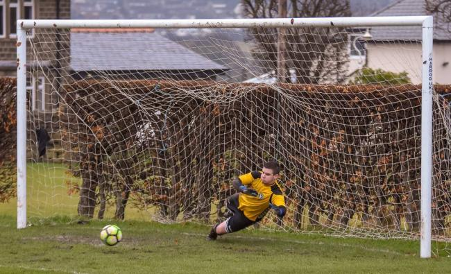 Joe Mash was in goal for Steeton Reserves in their 3-0 defeat at Lower Hopton Picture: John Chapman