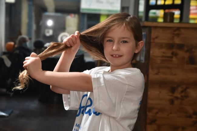 Evie Anderson, six, who has donated her hair to the Little Princess Trust after growing it for two years