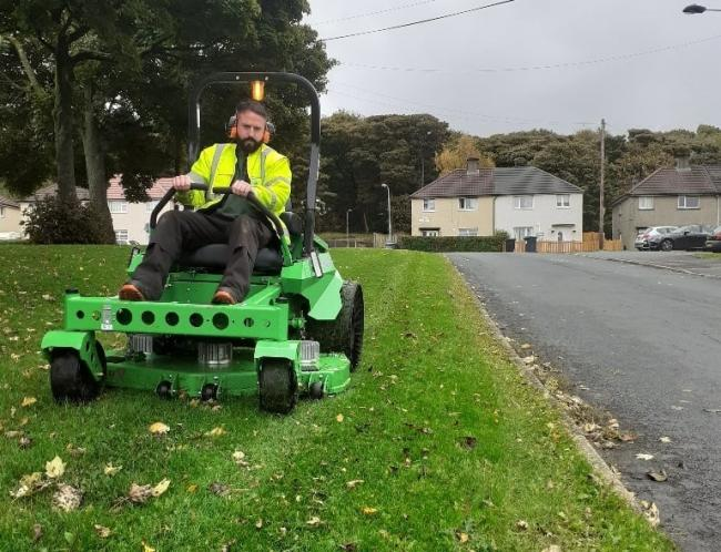 An electric mower is put through its paces