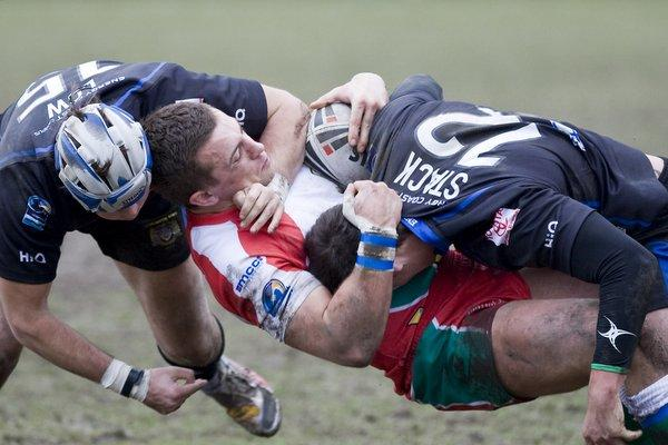 Ollie Pursglove is tackled against Workington. Picture by Charlie