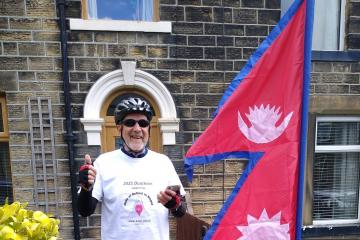 71 year old John cycles and runs personal best to help children in Nepal