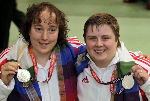 Michelle Smith, right, and Sharon Lee proudly show off their Commonwealth Games shooting silver medals