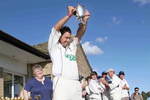 Foulridge skipper Chris Brooker-Carey lifts the Wynn Cup last season at Gargrave
