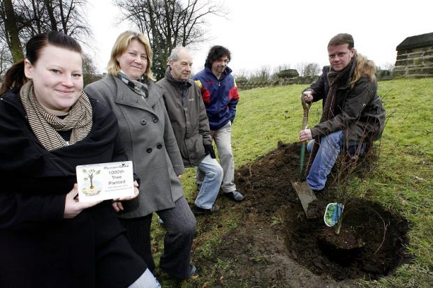 Michael Watmough plants the cedar tree in Cliffe Castle grounds with, from left, Marie Harris and Jayne Watmough of the Musicians Centre and Paul Skinner and Philip Rusworth of Cliffe Castle Park Conservation Group