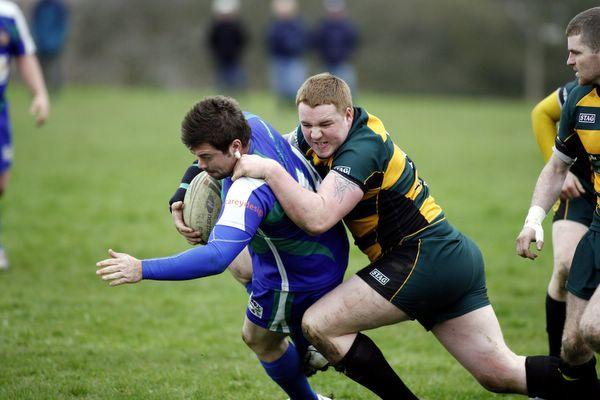 Silsden's Chris Greenwood is tackled against Slaithwaite